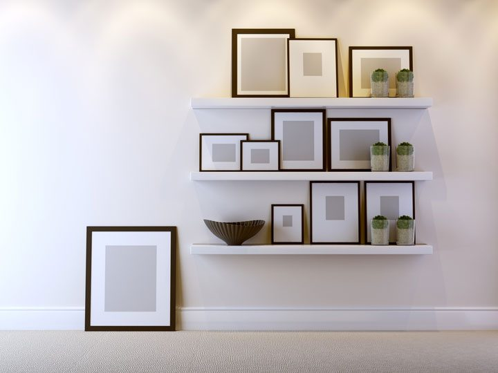 cheap, inexpensive home decor idea - photos or wall art in photo frame in wall gallery