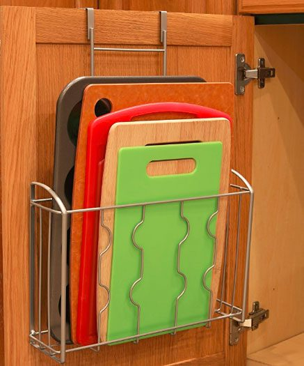 over the cabinet hanger under sink in kitchen to store cutting boards and baking sheets