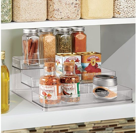 3 tiered shelf in kitchen cabinet holding spice and seasonings