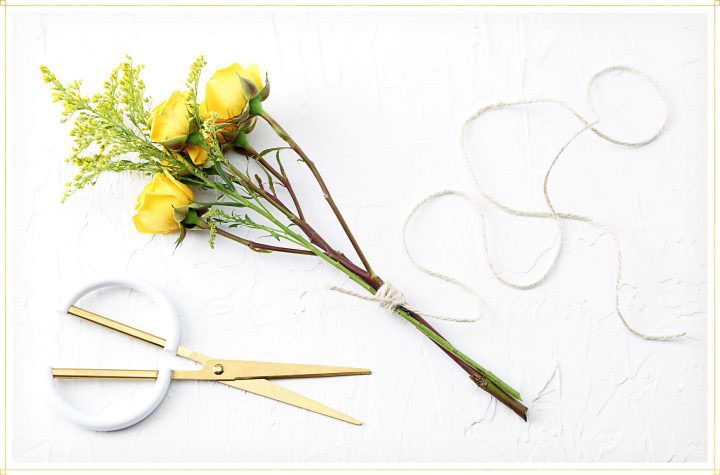 drying flowers step 2 - use string to tie bouquet together